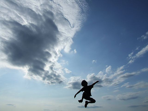 Child jumping in the sky
